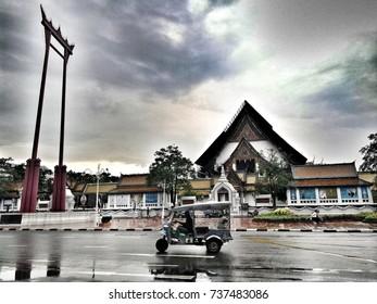Bangkok, Thailand - May 27, 2017: Tuk Tuk in front of Giant Swing and Wat Sutaht in Thailand.