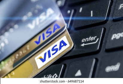 BANGKOK, THAILAND - MAY 28, 2017: Photo of  VISA credit card on the Keyboard, investment concept.