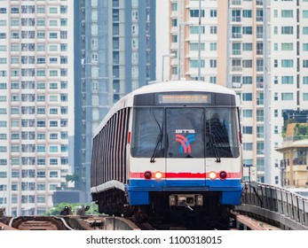 Bangkok, Thailand - May 28, 2018: Bangkok is building new commuter lines at a fast pace. Here is a 4 car train crossing the Chao Praya River at Saphan Taksin, with new condominiums in the background.