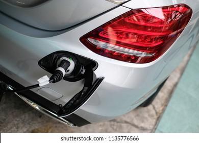 BANGKOK, THAILAND - MAY 28, 2018:  Mercedes Benz C350e Plug-in hybrid car with 3 pin Socket for EV Charger at rear bumper.