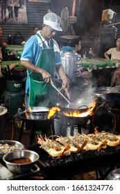 BANGKOK, THAILAND, MAY 28, 2019: sea food cook on Yaowarat Road, Bangkok, Thailand