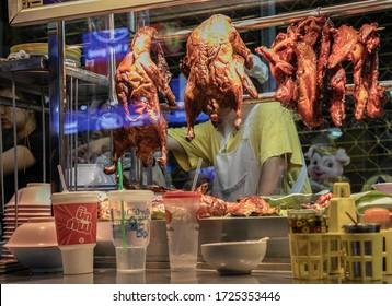 BANGKOK, THAILAND, MAY 28, 2019: street vendor of meat, Yaowarat Road, Bangkok, Thailand