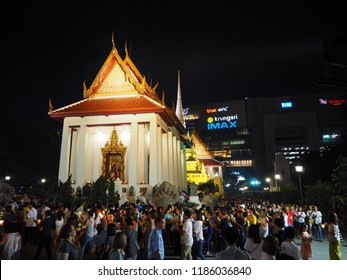 BANGKOK, THAILAND - May 29 2018: Night time at Wat Pathum Wanaram temple, Vesak Day, A Buddhist ceremony where people walk with lighted candles in hand around a temple
