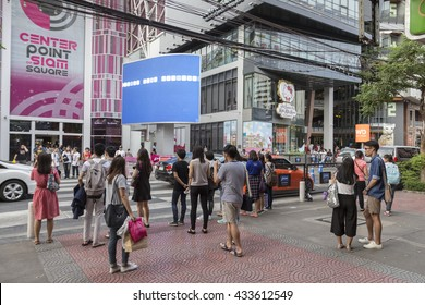 BANGKOK THAILAND - MAY 29 : group of people wait for walk across crosswalk opposite Digital Gateway at siam square on may, 29, 2016, thailand. siam square is famous shopping place of Bangkok