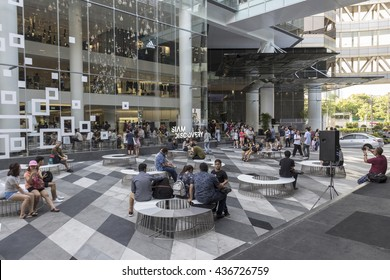 BANGKOK THAILAND - MAY 29 : people in space between Siam Center and Siam Discovery after renovate in siam square on may, 29, 2016, thailand. siam discovery is popular shopping mall in siam square