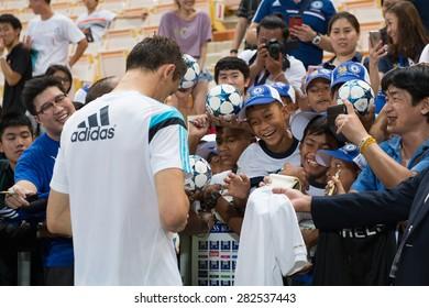 BANGKOK THAILAND MAY 29,Nemanja Matic of Chelsea FC  writes his name for fan during a Chelsea FC training session at  Rajamangala Stadium on May 29,2015 in Bangkok Thailand