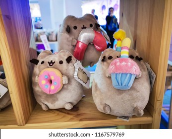 Bangkok, Thailand - May 3, 2018 : Pusheen cat is famous Facebook stickers and turned into merchandise product Pusheen the Cat plush and gifts and host Pusheen parties. Pusheen is a popular character.