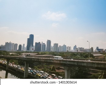 Bangkok, Thailand- May 3, 2019:City streets. Many cars are on the road.Many cars are running and driven on the highway.Behind there are many buildings.