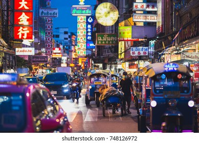 Bangkok, Thailand - May 30, 2017: Yaowarat Road, Chinatown central street, traffic including tuk-tuks & numerous Chinese signboards at night. Bangkok's Chinatown is a tourist attraction of the city