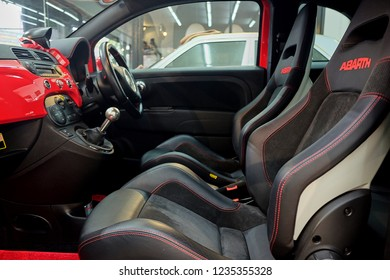 BANGKOK, THAILAND - May 31, 2018: Fiat's Abarth 695 Tributo Ferrari car leather seat. Interior of prestige sports car. Comfortable alcantara bucket seats. Black perforarated leather cockpit.