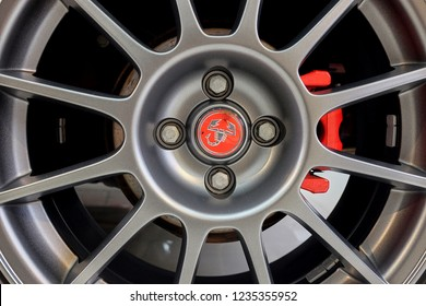 BANGKOK, THAILAND - May 31, 2018: The shiny Fiat's Abarth 695 Tributo Ferrari limited edition  rims with reflection on alloy wheel and red brake caliper after cleaning & coating. car detailing concept