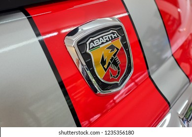 BANGKOK, THAILAND - May 31, 2018: The shiny Fiat's Abarth 695 Tributo Ferrari limited edition  logo with red glossy paint & tail light after paint polish & ceramic coat. Car detailing concept.
