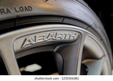 BANGKOK, THAILAND - May 31, 2018: The shiny Fiat's Abarth 695 Tributo Ferrari limited edition  logo on rims with reflection on alloy wheel after cleaning & coating. car detailing concept