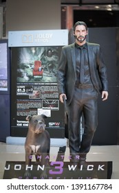 Bangkok, Thailand - May 4, 2019 :  A photo of John Wick and his pitbull dog, partner in crime. Life size figure of John Wick is located in front of theatre to promote movei John Wick 3 parabellum.