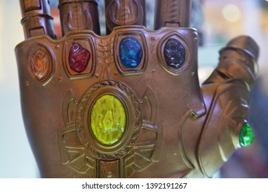 Bangkok, Thailand - May 4, 2019: Model of Thanos Mighty Glove Infinity Gauntlet from A Marvel Superhero Movie Avengers 4: Endgame Displays at the Theater