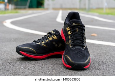 Bangkok, Thailand - May 4, 2019 :ASICS Running Shoes GT-2000 7 on track asphalt, ASICS is a Japanese multinational corporation athletic equipment company which produces footwear and sports equipment