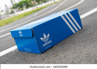 BANGKOK, THAILAND - MAY 4, 2019: Adidas Sign On Adidas Shoe Box. Founded in 1924 is a German multinational corporation that designs and manufactures sports shoes, clothing and accessories.