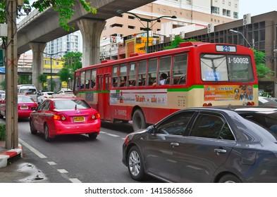 Bangkok, Thailand - May 5, 2015: Red city bus stuck in a traffic jam on Sukhumvit Road.