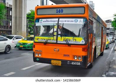 Bangkok, Thailand - May 5, 2015: Orange city bus on Sukhumvit Road.