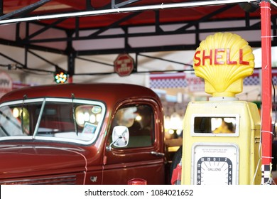 Bangkok, Thailand - May 5, 2018 : A photo of red retro pick-up truck nearby the SHELL gas station. This is a scene set up for display and take photo. Selective focus on the logo of SHELL.