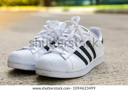 watch 5b116 ca576 BANGKOK, THAILAND - MAY 5, 2018   Adidas Superstar shoe white color stripes  black