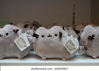 Bangkok, Thailand - May 6, 2017 : Pusheen cat is famous Facebook stickers and turned into merchandise product of soft plush pillow. Pusheen is a domestic shorthair cat. Editorial used only.