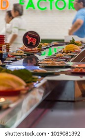 Bangkok, Thailand - May 8, 2016 : Unidentified chef cooking a food in the Japan food restaurant sushi conveyor or belt buffet for customer service in Thailand
