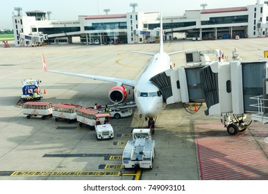 Bangkok, Thailand - May 8, 2017 : aircraft of Thai Lion Air parked at the airport and worker loads baggages into an airplane at Don Mueang International Airport