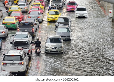 BANGKOK, THAILAND - MAY 8 : Thai flood hits Central of Thailand, higher water levels expected, cars navigating through the flood on MAY 8,2017 Bangkok, Thailand.