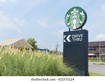 Bangkok, Thailand - May 9, 2016: Signs of a drive-through Starbucks stores in the country. Starbucks brand is one of the world famous from USA.
