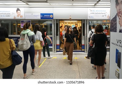 Bangkok Thailand - May 9, 2018: The passengers entering and people waiting to walk inside MRT subway train arrived on platform, City life style transportation of the Bangkok Mass Rapid Transit