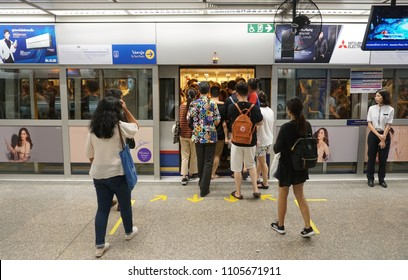 Bangkok Thailand - May 9, 2018: The The passengers walking to the inside MRT subway train arrived in the rush hour, City life style transportation of the Bangkok Mass Rapid Transit