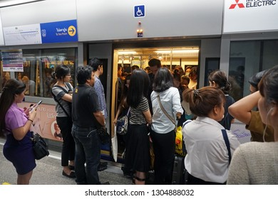 Bangkok Thailand - May 9, 2018: The crowded passengers entering MRT subway train arrived and people waiting to enter inside in rush hour, Transportation of the Bangkok Mass Rapid Transit