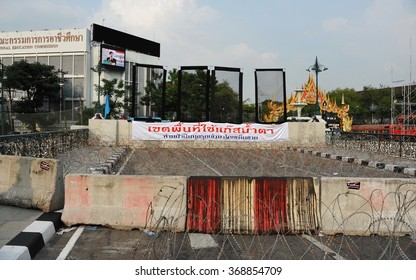 BANGKOK, THAILAND - NOV 11, 2013: Riot police stand guard at a barricade near parliament during an anti government rally. Over 30,000 police are deployed at government sites amid street protests.
