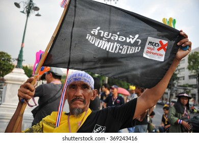 BANGKOK, THAILAND - NOV 11, 2013: A muslim man holds up a flag during a city centre anti government rally. The Thai capital is experiencing ongoing political instability and daily street protests.
