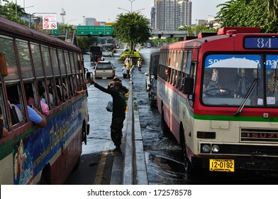 BANGKOK THAILAND- NOV 13: Unidentified people donate food and water for people on the bus on  flood street  on November 13, 2011 in Pra Pin Klao Brigde, Bangkoknoi, Bangkok, Thailand.