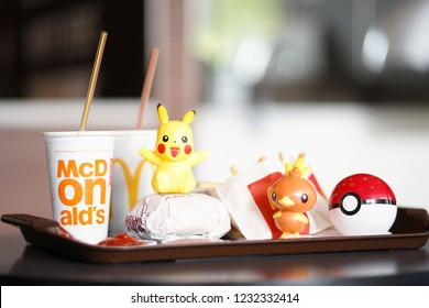 Bangkok, Thailand - Nov 17, 2018 : A photo of Happy Meal set at McDonald's with Pokemon plastic toys launch to promote Pokemon let's go pikachu and Pokemon Let's go Eevee by Nintendo.