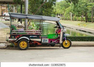 BANGKOK, THAILAND - Nov 24, 2013: Tuktuk in downtown Bangkok, traditional taxis. Tuktuk is popular among tourists