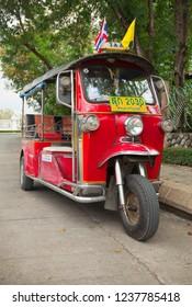 BANGKOK, THAILAND - Nov 24, 2013: Tuktuk in downtown Bangkok, traditional taxis. Tuktuk is popular among tourists and residents cities