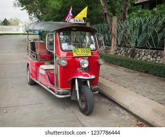 BANGKOK, THAILAND - Nov 24, 2013: Tuktuk in downtown Bangkok, traditional taxis. Tuktuk is popular among residents cities and tourists