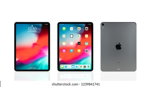 Bangkok, Thailand - Nov 24, 2018: Studio shot of new Apple iPad pro 2018 space gray color, display home and lock screen and rear view logo. Isolate on white background. Illustrative editorial content
