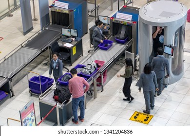 BANGKOK, THAILAND, NOV 27 2018, Control passengers and his baggage at the airport. Security officers at the airport works at body scanner for checked of people before departure.