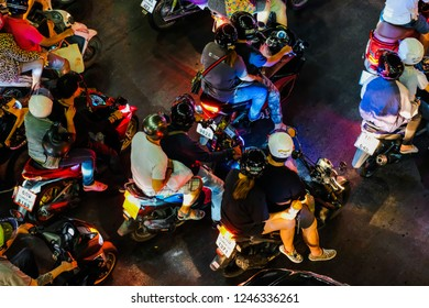 Bangkok Thailand - NOV 29 2018: the night traffic of motorcyclists wait at a junction during rush hour