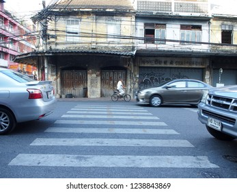 Bangkok, Thailand, NOV-5-2018 : Zebra crossing line on road with vehicles and old buildings in China town  (or Yaowarat)
