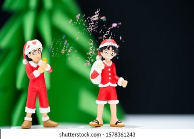 Bangkok, Thailand - Novembe 20, 2019 : Photo of Monkey D. Luffy and Usopp wear santa suit ready for Christmas celebration season.Japanese manga animation One Piece.Editorial illustrative.