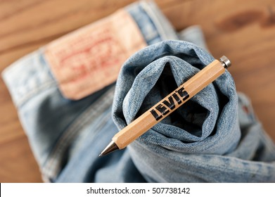 BANGKOK, THAILAND - NOVEMBER 01, 2016: An old wooden souvenir pen from LEVI's. LEVI'S is a brand name of Levi Strauss and Co, founded in 1853.