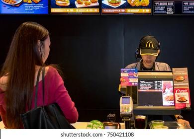 BANGKOK, THAILAND - NOVEMBER 05: An fast food employee takes orders from a customer in Mcdonald's counter in Bangkok, on November 05, 2017.
