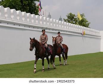 Bangkok. Thailand - November 08 2019: Thai Police riding horses to patrol around the Royal Palace in Bangkok, Thailand.