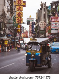 Bangkok, Thailand - November 09, 2017 : Transport Tuk Tuk car in traffic in Yaowarat Road main street in chinatown, Thailand's iconic tricycle taxi.