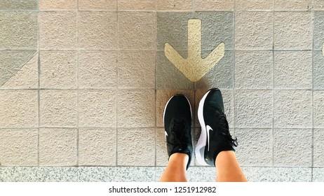 BANGKOK, THAILAND. NOVEMBER 1, 2018: the runner wears running shoes branded Nike Odyssey React in black color